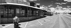 burra-lr-pano-2398-ps-w (pw-pix) Tags: outback town mining historic hot dry weathered clouds cloudy shops buildings mainstreet shoppingstrip motorcycle motorbike touringmotorcycle bmwr1200rt r1200rt ir infrared bw blackandwhite 720nminfrared irmodifiednikon1v1 commercialstreet barrierhighway burra outbacksa sa southaustralia outbackaustralia australia