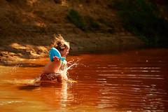 Flaming Water (Michael Angelo 77) Tags: potrait toddler girl water river orange fun splashingwater lutterzand splash twente