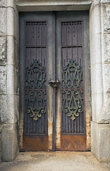 mausoleum gate (Usually Melancholy) Tags: iron doors lock creativecommons 4576 canonef1635mmf28liiusm padpock