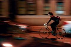 SPINNING (Oscar M. Cardoso) Tags: nightphotography cars girl bike speed traffic streetphotography bicicle nighttraffic traficlights