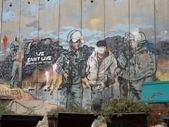 Graffiti op muur bij kamp Aida