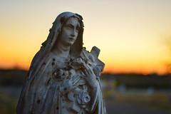 Day's end (radargeek) Tags: sanfelipecemetery delrio cemetery statue sunset grave texas tx cross saintthérèse thelittleflower sttherese