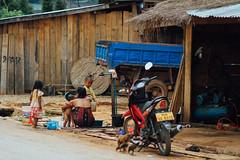 Bathing Outside Motorcycle Repair Shop, Nam Nga Laos (AdamCohn) Tags: 025kmtobannamkouatinoudômxailaos adamcohn bannamkouat lao laos oudômxai bath bathe bathing child children geo:lat=20576423 geo:lon=102122902 geotagged mother motorcycle roadside wash wwwadamcohncom namnga oudomxayprovince