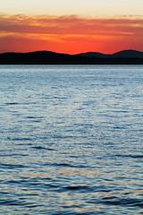 Vertical Seattle Sunset (matthewkaz) Tags: sunset elliottbay pugetsound water reflection reflections sky clouds olympics olympicmountains mountains silhouette city seattle washington 2017