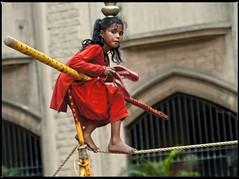 young funambulist , ready to go (travelben) Tags: street people india art girl walking asia circus candid rope panasonic walker bombay barefeet acrobat tightrope mumbai cirque inde equilibrist funambulist acrobal