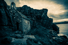 St Govans Chapel (Andrew Gibson.) Tags: ocean longexposure sea sky blackandwhite cliff cloud monument water wales clouds sunrise landscape pembroke seaside sand rocks waves outdoor fluffy shore pembrokeshire chappel stgovanschapel stgovanshead bellrock saintgovanschapel saintgovanshead sonya77
