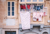 Raiders of the Maltese Falcon (Chapter Fourteen: Desperate to find the statue) (Sator Arepo) Tags: old facade canon malta line clothes wash laundry rack hanging 5d 24mm washing tse valletta markii