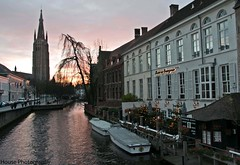 Brugge Sunset ({House} Photography) Tags: christmas xmas trip travel sunset sun church river boats canal europe december view belgium brugge bruges 2015 housephotography timothyhouse
