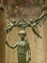 Closeup of Greek mirror depicting Aphrodite (?) with flanking Erotes (cupids) said to be from an Etruscan tomb 465-450 BCE Bronze (mharrsch) Tags: greek etruscan mirror aphrodite maiden erote cupid winged goddess deity myth religion bronze ancient 5thcenturybce nelsonatkins museum kansascity missouri mharrsch