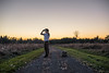Dusk is when the creatures come out (jonbarton) Tags: selfportrait ontario canada kingstonontario dusk conceptual path binoculars autumn lemoinepoint portrait landscape field