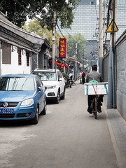 Cyclist along Cuihua Hutong (street or alley), Dongcheng area, Beijing (Victor Wong (sfe-co2)) Tags: yuexiandeliciousfood adult alley ancient architecture asia asian beijing building charm china chinatown chinese city colors cuihua culture cyclist decoration dongcheng east historic holiday house hutong indigenous landmark lantern lifestyle men old oriental outdoor people red residential restaurant road stores street style tourism town traditional travel urban vintage workers