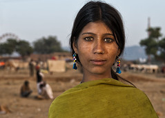 Mamta (Blinkofanaye) Tags: portrait woman india girl yellow evening eyes dusk indian fair earrings pushkar rajasthan ajmer