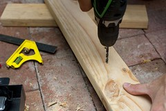 Carpenter drilling a hole in a plank of wood (printstest) Tags: wood diy portable hole hobby renovation bit tool woodworking carpentry drill carpenter powertool drilling joinery