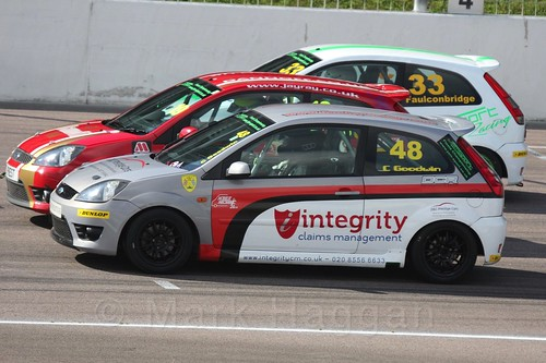 Mark Faulconbridge, Samuel Priest and Callum Goodwin race three abreast in Fiesta Racing at Rockingham, Sept 2015
