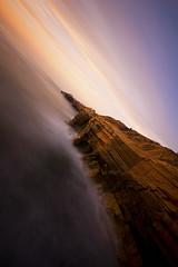 Sunset Cliffs (I take photographs) Tags: ocean california ca sky cliff water rock canon photography pacific sandiego wave shore sunsetcliffs t3i breach ndfilter 600d dutchtilt longexplsure