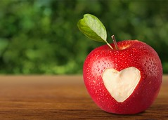 Heart Shape on Apple. (slankogblid) Tags: apple background bite biting candid cut day eating food freshness fruit green healthy heart individuality isolated leaf lifestyle love macro missing nature red romance shape sweet symbol valentines white