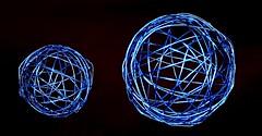 see-through Christmas balls (HansHolt) Tags: christmas navidad noël weinachten kerstfeest baubles balls ornaments bolas bambalinas christbaumkugeln kerstballen wire draad seethrough seethru open transparent veratravés voiràtravers durchschauend durchscheinend doorzichtig blue metal tabletop canon 300d 100mm canoneos300d canonef100mmf28macrousm