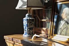 Still Life with Portrait and Antique Books (smilla4) Tags: interior stilllife furniture lamp shadows antiquebooks books blueandwhite maine reflection