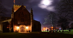 Silent Night (Peter.S.Roberts) Tags: interestingness interesting silentnight church cathedral stasaph december winter christmas longexposure grounds trees graves gravestones headstones calm peaceful quiet tranquil moon moonlight clouds night spire historic tower welsh cymru northwales lighting arches stainedglass windows entrance holyground gothic shadows archeddoors history old dark evening landscape silhouette anglicanchurch