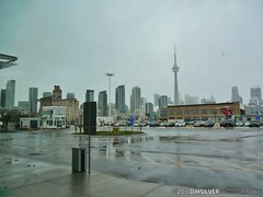 First view of the City (djhsilver) Tags: toronto gta gotrain go train air travel flying clouds harbourfront