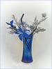 WINTER BLUES (strandviewphotos) Tags: floralarrangement blue vase pinecone silver glitter