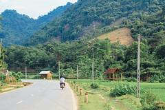 Motorbike on Rural Vietnamese Road (AdamCohn) Tags: 079kmtobnmayinsnlavietnam adamcohn bnmay snla sơnla vietnam geo:lat=21394918 geo:lon=103772054 geotagged hills karst mountains wwwadamcohncom chiềngpấc