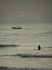 Surfer, boat and sunset (ungkebohang) Tags: beachlife surfer sunset surf landscape people kuta bali monochromatic