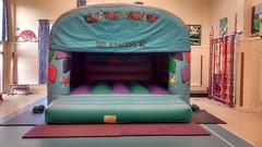 Celebration themed 16x16 bouncy castle, suitable for kids as well as adults. From only £80 per hire.
