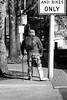 carry on (mitchell haindfield) Tags: disability impairment immobilized mobility injured rehabilitation perseverence determination faith optimism struggle strength courage famousquotation streetphotography busstop achievement monochrome physical limitations inspiration inspirational