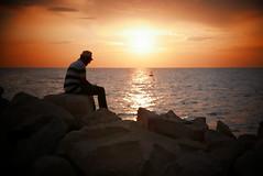 Piran rocky beach (andrewobrien2) Tags: sea water mediterranean panasonic slovenia piran peninsula adriatic istria istrian lx100