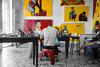 Artist Working (buddythunder) Tags: pictures travel red portrait yellow work us artist legs flag cuba environmental tights change cienfuegos selectivecolor hunched