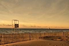 (Scott Glenn) Tags: sunset lighthouse fence evening pier sand waves stjoseph windy lifeguard lakemichigan greatlake silverbeach puremichigan