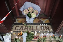 At the door of Carillon (Ennya2000) Tags: door flowers paris france candles carillion