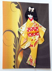 ATC1301 - Tomomi (tengds) Tags: flowers red white yellow atc artisttradingcard asian japanese card geisha bow kimono obi swirls ochre paperdoll origamipaper artcard papercraft japanesepaper ningyo handmadecard chiyogami darkbrown hairbow designprint japanesepaperdoll origamidoll kimonodoll tengds