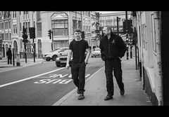 The Lads (Howie Mudge LRPS) Tags: man men male people friends lads shrewsbury shropshire town walk walking card buildings architecture outside outdoors blackandwhite blackwhite mono monochrome monochromatic candid casual lights doors windows pavement road street streetphotography streetlife urban urbanphotography england cinematicstyle panasonicdmcgx80 lumix microfourthirds m43 mft compactsystemcamera mirrorlesscamera photography
