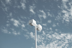 DSC00737 (Praxis Transmutation) Tags: sandiego sunlight sigma sony a6000 street light pole parking lot 30mm lookup clouds sky daylight sunshine lights california blue white grey