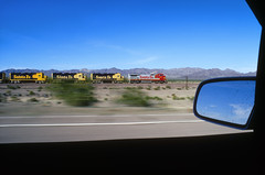 Warbonnet kicks on Route 66 (Moffat Road) Tags: santafe atsf atchisontopekaandsantafe ge b408w 528 pacing blur speed mirror mojavedesert route66 highway66 amboy california locomotive warbonnet superfleet train railroad ca