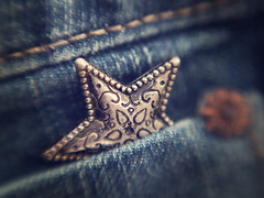 Catch a Falling Star (Explored January 9, 2017) (Anne Worner) Tags: 1957 1959grammysongoftheyear anneworner catchafallingstar em5 inspiredbyasong lensbaby macromondays perrycomo blue bluejeans closeup denim fabric inpocket jeans macro olympus pocket pointed rivet silver star stitching sweet50 weave selectivefocus blur bend bendy texture on1 brilliant wow