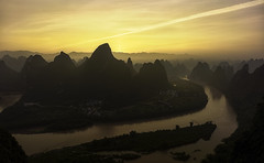 In the magical world. (Massetti Fabrizio) Tags: guilin guangxi giallo green guanxi landscape landscapes cina china cambo clouds river mountain mount yellow yangshou xianggongshan xiangtangshan fabrizio massetti red sunrise sun sunlight sunset rodenstock phaseone iq180