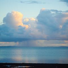 Wellington Point Rain (Lesmacphotos) Tags: wellingtonpoint sunrise beach sea pier landscape water clouds raincloud cloud blue