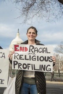 Catarina Correia Holds a Sign Outside the Ziglar v. Abbasi Hearing at the U.S. Supreme Court
