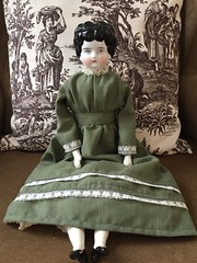 Snow Day Sewing (Foxy Belle) Tags: doll handmade antique china head shoulder plate low brow germany green dress black toile sew sewing recycled
