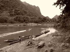 Ouvrez vos livres d'histoire ou...d'histoires Open your history or ...storybooks (alainpere407) Tags: alainpere triptolaos laos muangngoi boats sepia river riviere simplysuperb