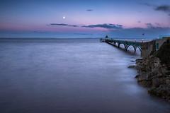 Moonset Hightide (~g@ry~ (clevedon-clarks)) Tags: moon moonset longexposure dusk pier clevedon clevedonpier rocks northsomerset landscape seascape pink purple blue coast coastal uk england europe