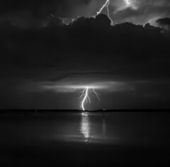 Power and Beauty (tshabazzphotography) Tags: lightning lighteningstrike mothernature nature outdoors landscape cloudporn cloud cloudy dark longexposurephotography centralfloridaphotographer danger deadly serene brightlights timing laketoho lake toho random sudden monochrome outdoor blackandwhite powerful electric