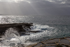 Energy (kurjuz) Tags: ghawdex gozo malta xattlahmar cloud haze rays rock saltpans sea seascape spray sun waves