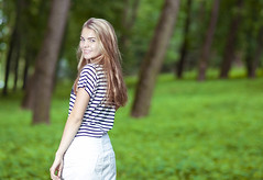 Teenagers Lifestyle Concepts. Portrait of Smiling Blond Caucasian Teenager Posing in Green Forest Outdoors. (DmitryMorgan) Tags: 1 1319years attractive beautiful blond blondyhair casual caucasian cheerful concept cute day enjoying female forest happy holidays joyful leisure leisureactivity lifestyle lifetime lovely one outdoors park positive relaxing skirt smiling standing stripe stripy stylish summer sunglasses sunny teen teenager vacation white younggirl youth