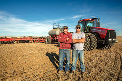 Proud Farmers (www.toddklassy.com) Tags: autumn red tractor west men fall field horizontal rural season outdoors montana mt farm wheat country farming working seed nobody farmland case equipment machinery rows western growing farmer organic prairie agriculture hansen planting cultivation agricultural ih goldentriangle easternmontana greatplains cultivated cultivate implement internationalharvester winterwheat seeding airdrill notill grower cerealcrop colorimage seeder caseih gildford aircart countryskde hinebauch bahnmiller