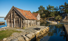 Boathouse with a soul ⚓ (Ranveig Marie Photography) Tags: pictures ocean old sea people man motion reflection water grass sunshine norway stone architecture forest buildings coast harbor boat norge wooden woods october rocks photos harbour pics stones decay norwegen bluesky images quay norwegian nostalgia photographs shore kai skog noruega tres nordic blueskies seashore havn decayed bilder båt jæren sandnes arkitektur rogaland brygge vestlandet norsk båthavn sjø kyst nordisk coas norvège boathouses sealine naust gammelt kysten nøst båthus sjøhus sigmaart nikond5200 sigmaart1835mm ranveigmarienesse ranveignesse lauvåsvågen