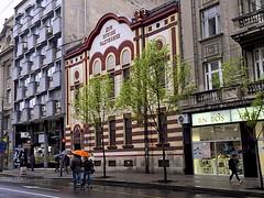 Belgrade Architecture (oxfordblues84) Tags: trees building tree wet water rain architecture umbrella spring europe serbia pedestrian rainy pedestrians belgrade vikingrivercruise terazije orangeumbrella overcasst теразије passagetoeasterneurope